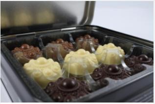 Bewaarblik Zeeuwse knop bonbons en boekje zoet uit zeeland